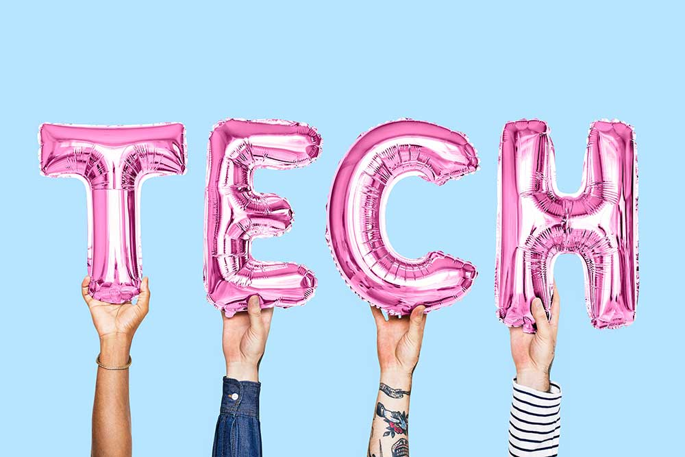 people holding tech letters balloons